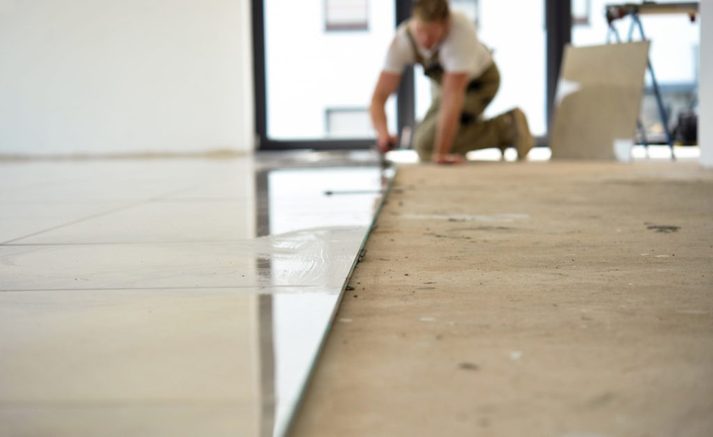 laying tiles in home